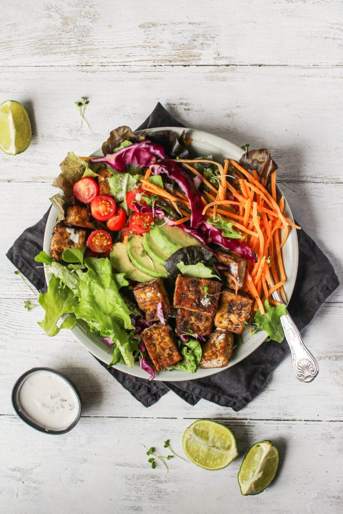 Jerk tofu in a bowl with salad