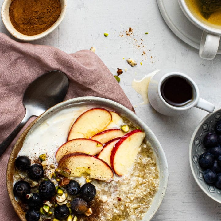 Quinoa porridge with apples, blueberries, yogurt and nuts