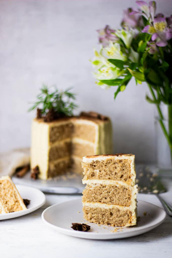 Eye level photo of chai spiced cake with slice cut out