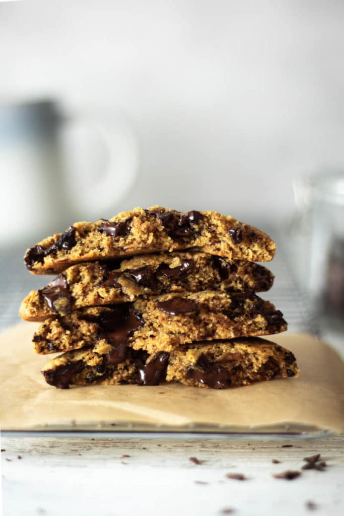 stack of chocolate chip cookies with melting chocolate