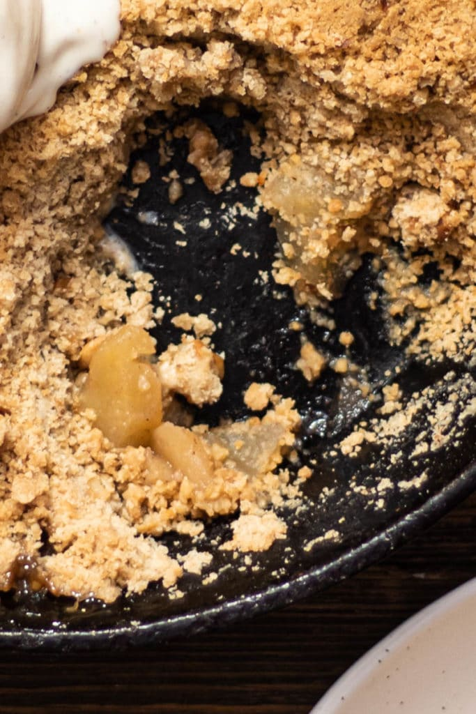 walnut apple crumble with scoop of ice cream