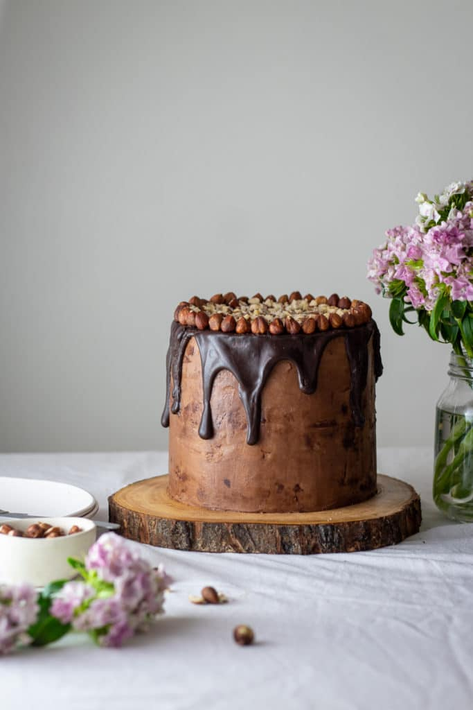 Eye level photo of whole hazelnut mocha cake