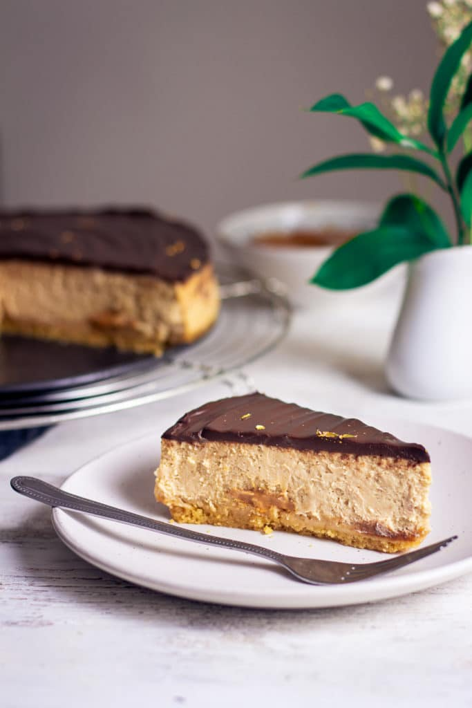 Slice of millionaire's cheesecake with fork