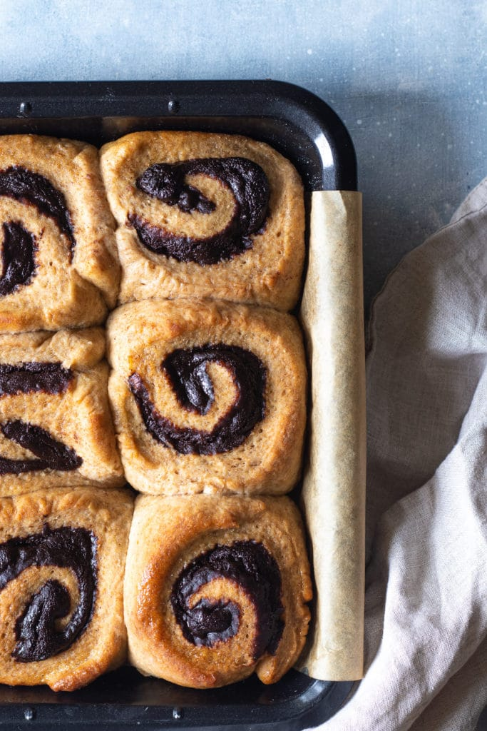 Overhead photo of chocolate maple rolls in a baking tray
