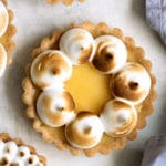 overhead photo of lemon tarts topped with torched Italian meringue