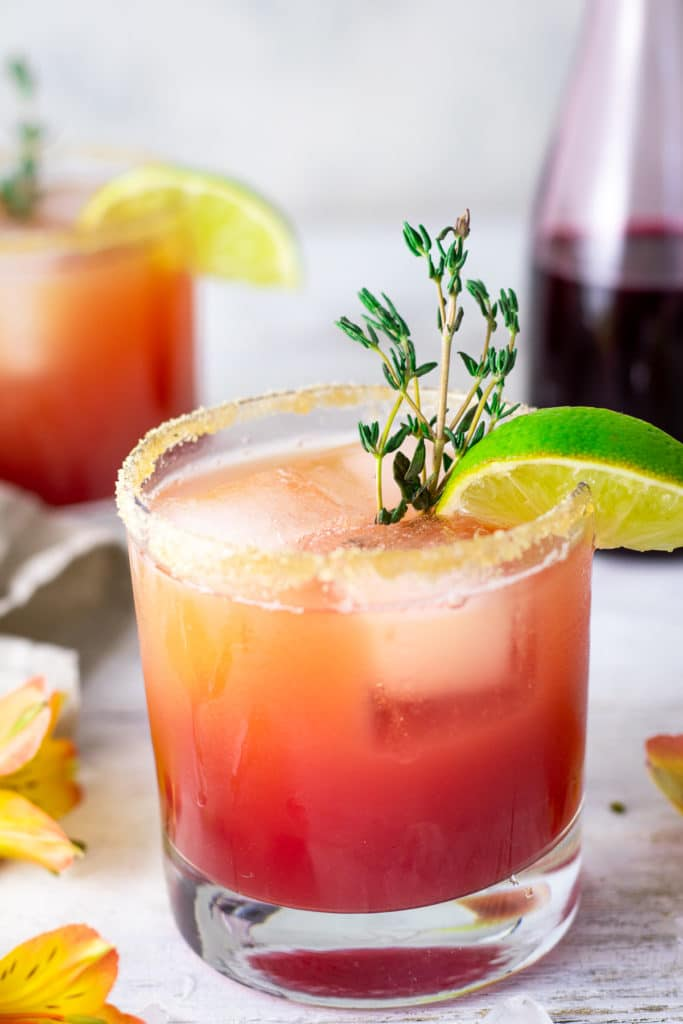 Close up of rum punch with thyme and lime