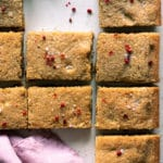 overhead photo of pink peppercorn blondies sprinkled with salt and pink peppercorns